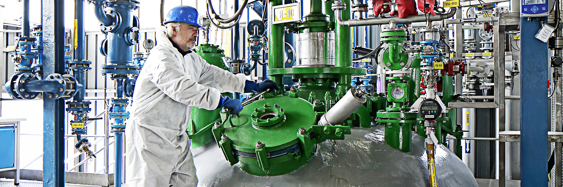 CordenPharma operator in PPE working with reactor in cGMP facility
