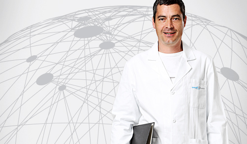 CordenPharma scientist in lab coat holding binder for News & Press header with white global connectivity background