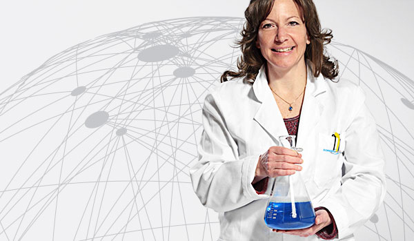 CordenPharma scientist holding Erlenmeyer flask & blue liquid for Careers header with white global connectivity background